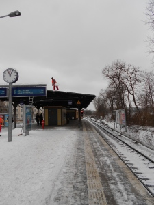 Shoveling snow off the metro in Berlin.