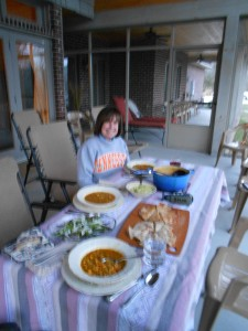 Carolyn, ready to enjoy her own superb cooking!