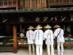 Some ohenro buying gingersnap-like cookies at a traditional shop near Zentsuji, temple 75.